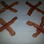 lay your partially cooked bacon on a tray in a X formation.