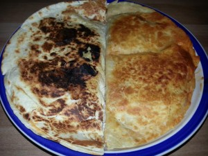 No butter was used on the chicken quesadilla on the left. The quesadilla on the right had 1/2 tbl of butter.