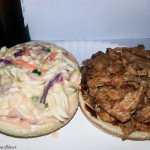 Pulled pork sandwich topped with homemade coleslaw.